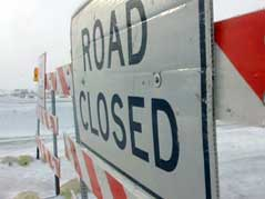 road closed sign interstate 90 snow blowing wind cold #010710