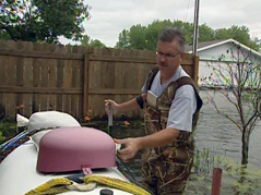 man fixes propane tank