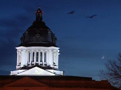 pierre state capitol building dome night shot moon