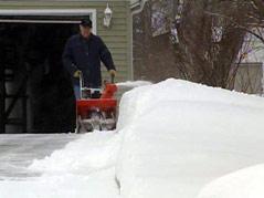 cold weather winter snow snowblower bundled up