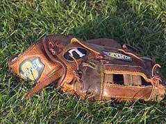 baseball mitt glove sioux falls SEBA traveling teams field grass summer