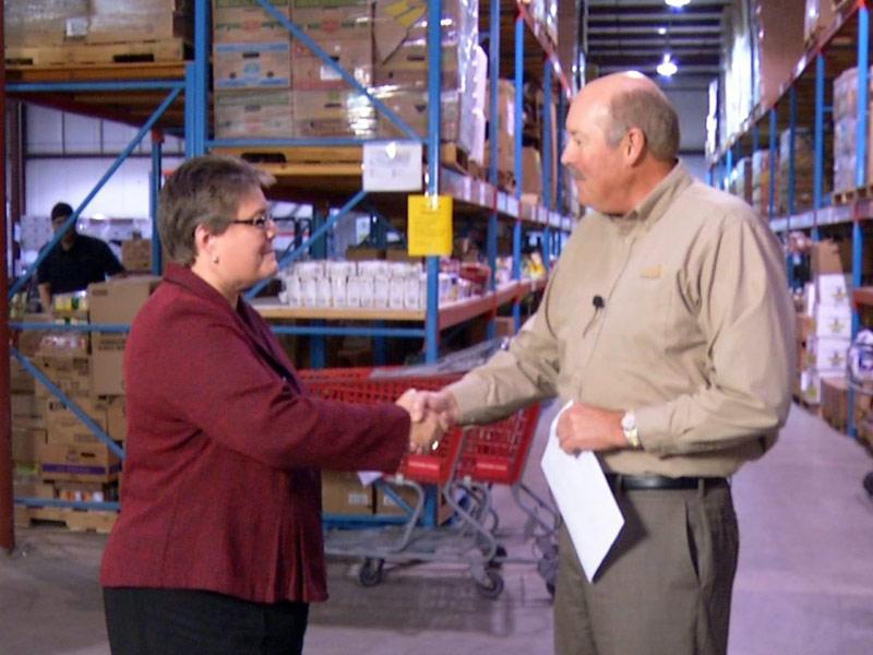sioux falls food bank pantry KELO donates check Lisa Blankers