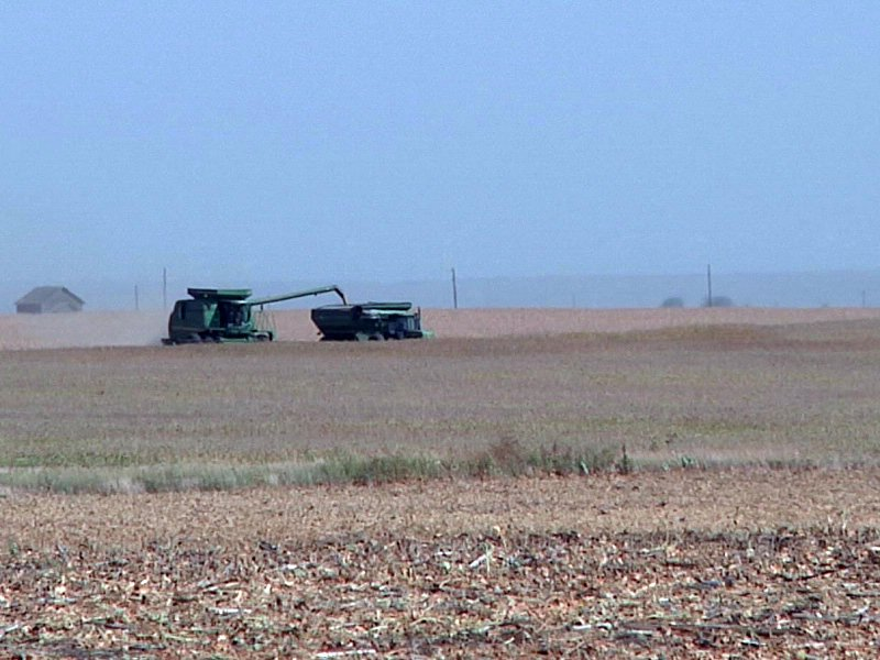 crop harvest fire danger drought combine field agriculture farming