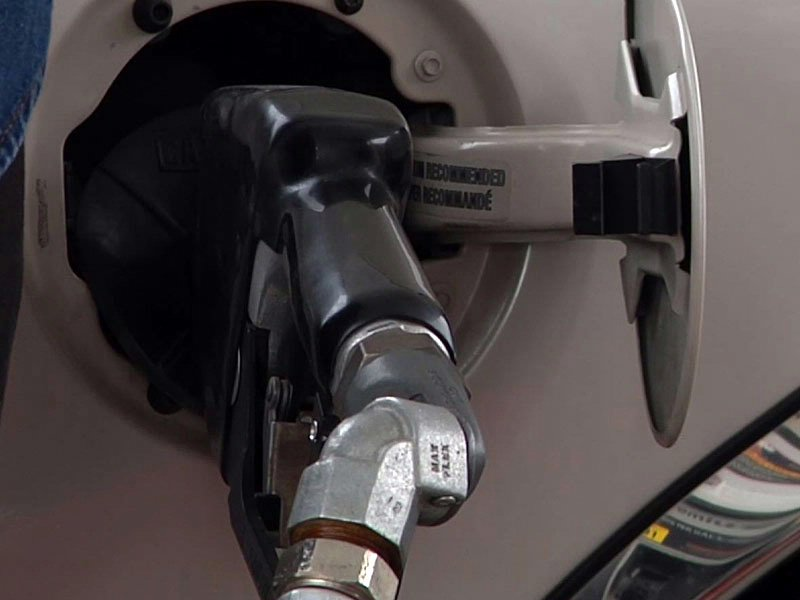 gas prices pump fuel fueling up vehicle