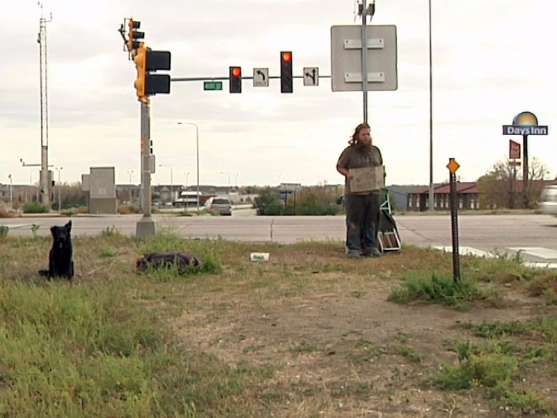 panhandler with dog i29 and 41st street sioux falls
