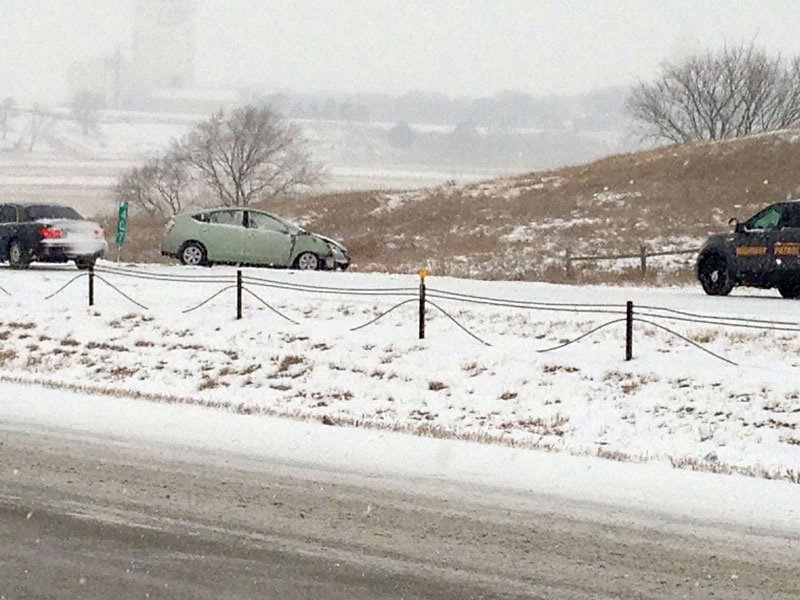 interstate 90 mm 407 snow slick conditions cars in ditch phone photo