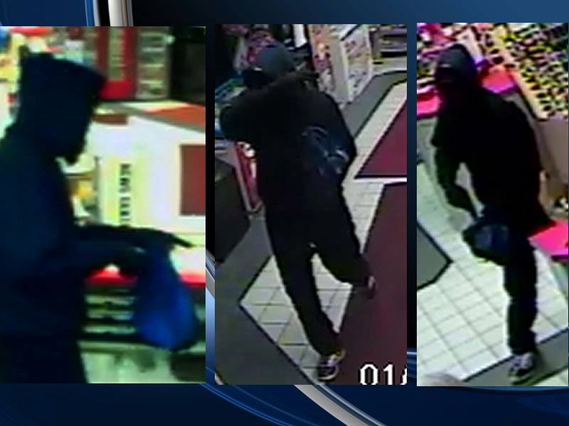 surveillance photo BP gas station armed robbery suspect
