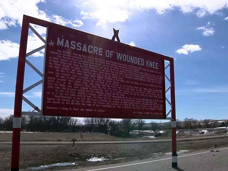 massacre at wounded knee sign