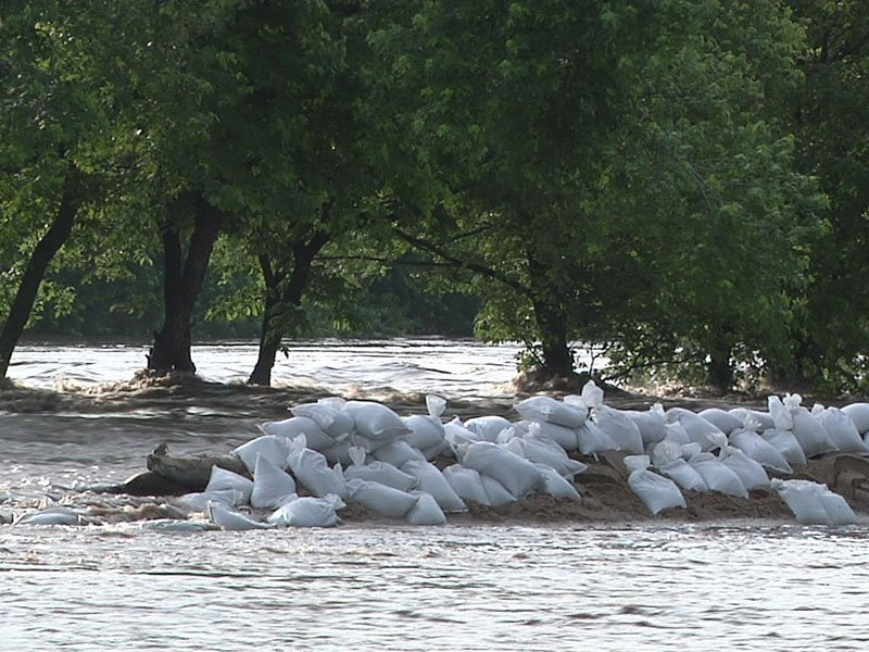 flooding river water sandbags