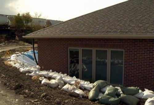 Sandbags surrounding home in Marion