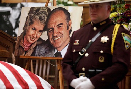 A photo of McGovern and his wife near the casket.