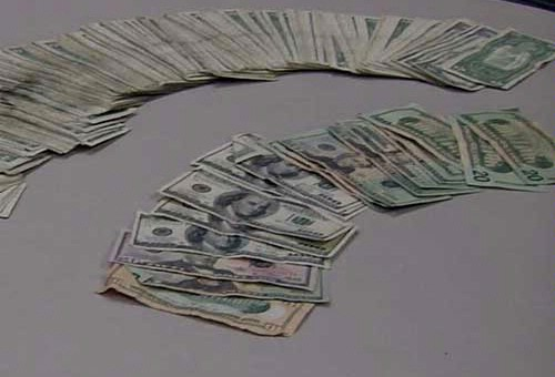 Cash adding up to more than $1,000 was found