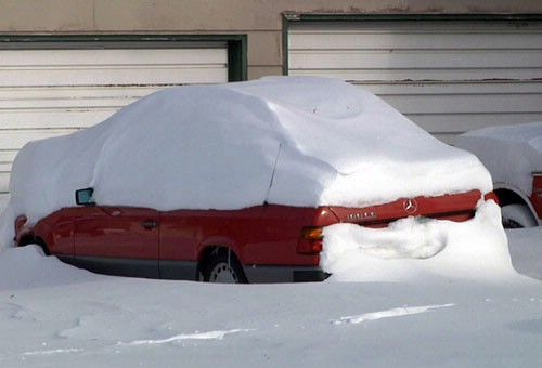 A car remains buried under snow