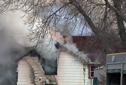 Flames coming out of the top of the home
