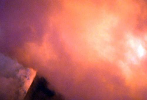 Smoke Surrounds The Flames