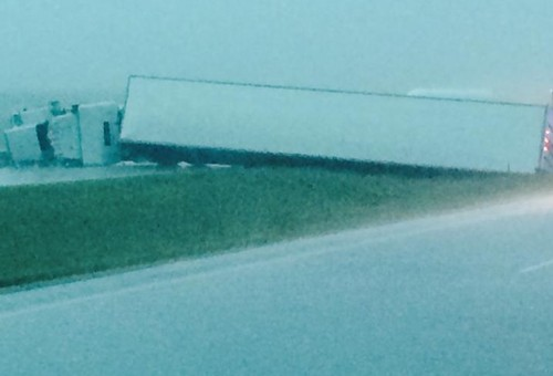 Semi blown over by wind on I90