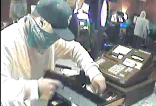 Suspect taking cash