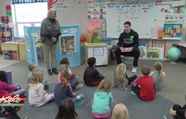 USF Men's Basketball Team Visits John Harris Students
