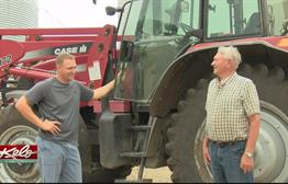 Father And Son Continue Farming Tradition